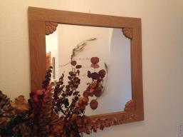 Mirror with handcarved wooden framr